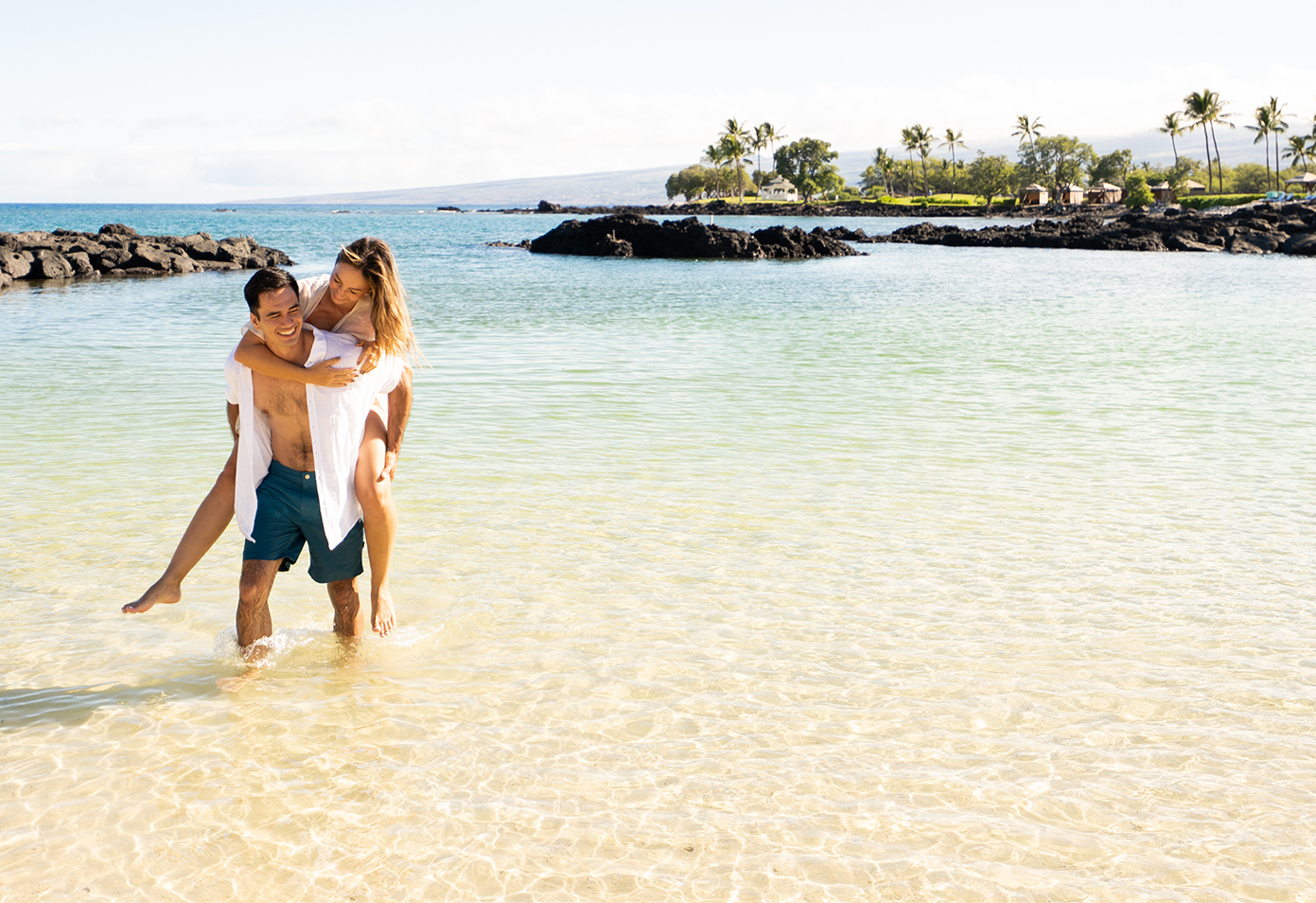 Couple at the beach at Fairmont Orchid, Hawaii